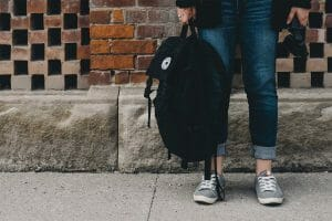 Image of student holding a book bag